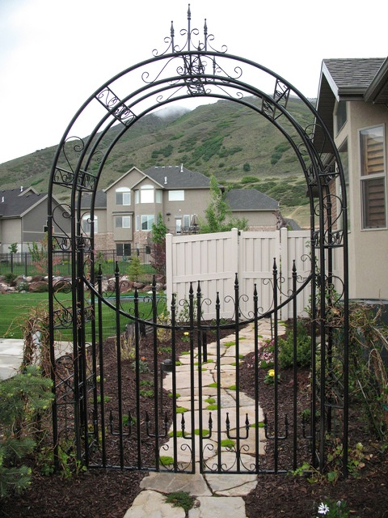 iron-anvil-gates-by-others-man-concave-with-arbors