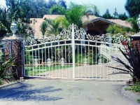 iron-anvil-gates-by-others-driveway-arch