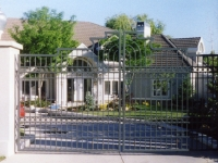 iron-anvil-gates-by-others-driveway-french-curve-tall-oaks-copy