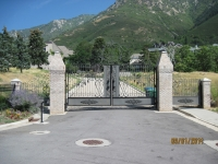 iron-anvil-gates-by-others-driveway-scroll-above-pepperwood-subdivision