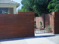 iron-anvil-gates-by-others-man-arch-small-pattern