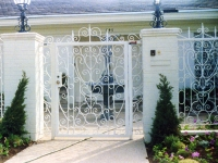 iron-anvil-gates-by-others-man-flat-fancy-scrolls