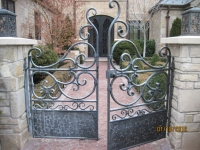 iron-anvil-gates-by-others-man-scroll-doors-provo-subdivision