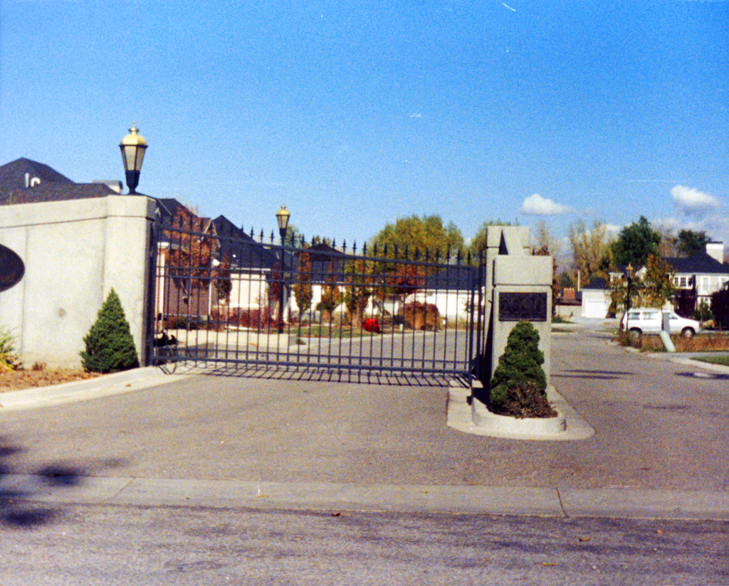 iron-anvil-gates-driveway-concave-on-6200-s