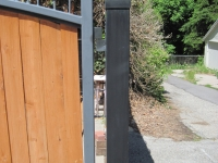 iron-anvil-gates-driveway-arch-barker-wood-insert-2