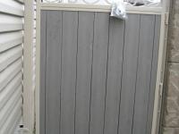 1_61-0091-Iron-Anvil-Gates-Man-Arch-GILBERT-16555-IRON-AND-TREX-WOOD-GATE-99-