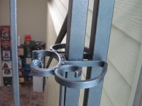 iron-anvil-gates-man-arch-la-brett-litster-15925-latch-springbar