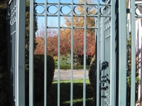 iron-anvil-gates-man-flat-tall-oaks-entry