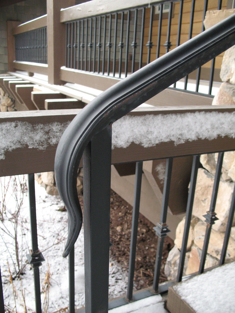 iron-anvil-handrails-post-mount-termination-moulded-cap-snake-tongue-ross-handrail-glenwild