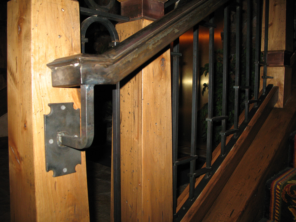 iron-anvil-handrails-wall-mount-molded-cap-stein-erickson-son-lodge-rail-by-others
