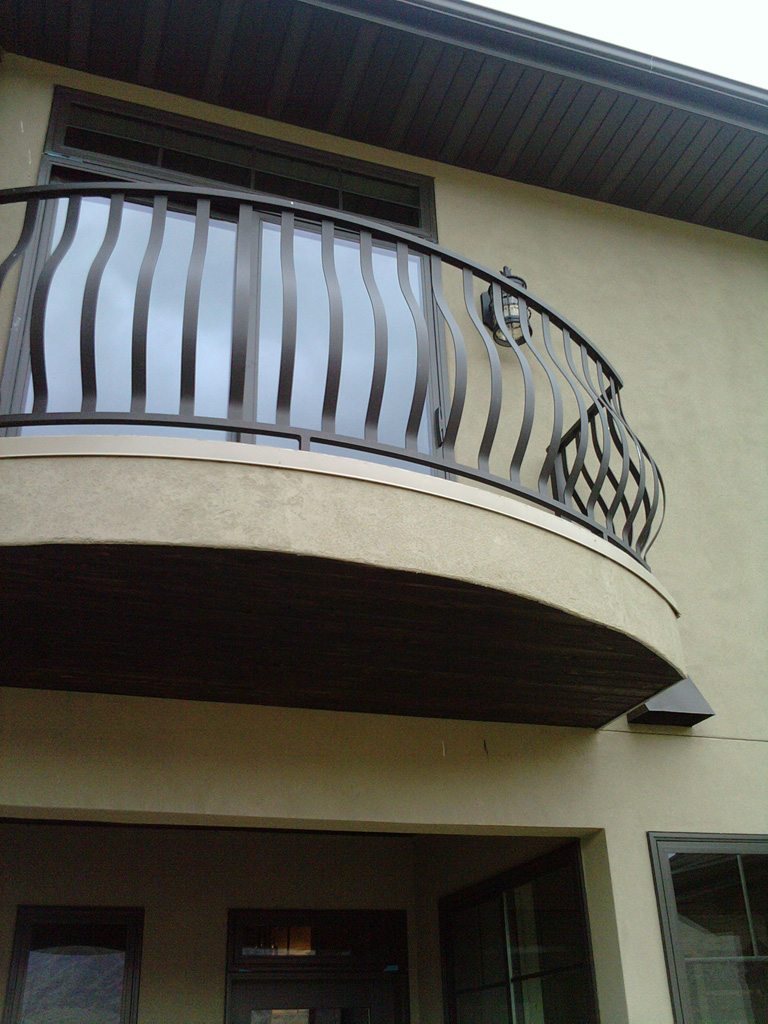 iron-anvil-railing-belly-rail-single-top-flat-bar-prows-erda-railing-by-others