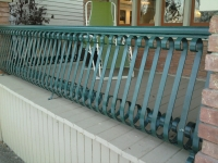 iron-anvil-railing-belly-rail-single-top-flat-bar-s-scroll-fontaine-532-n-center-st-by-others