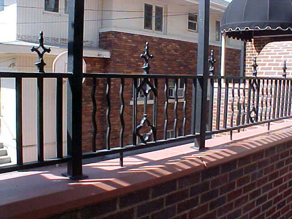 iron-anvil-railing-by-others-rail-spiral-stair-virgina-street-2-1-1