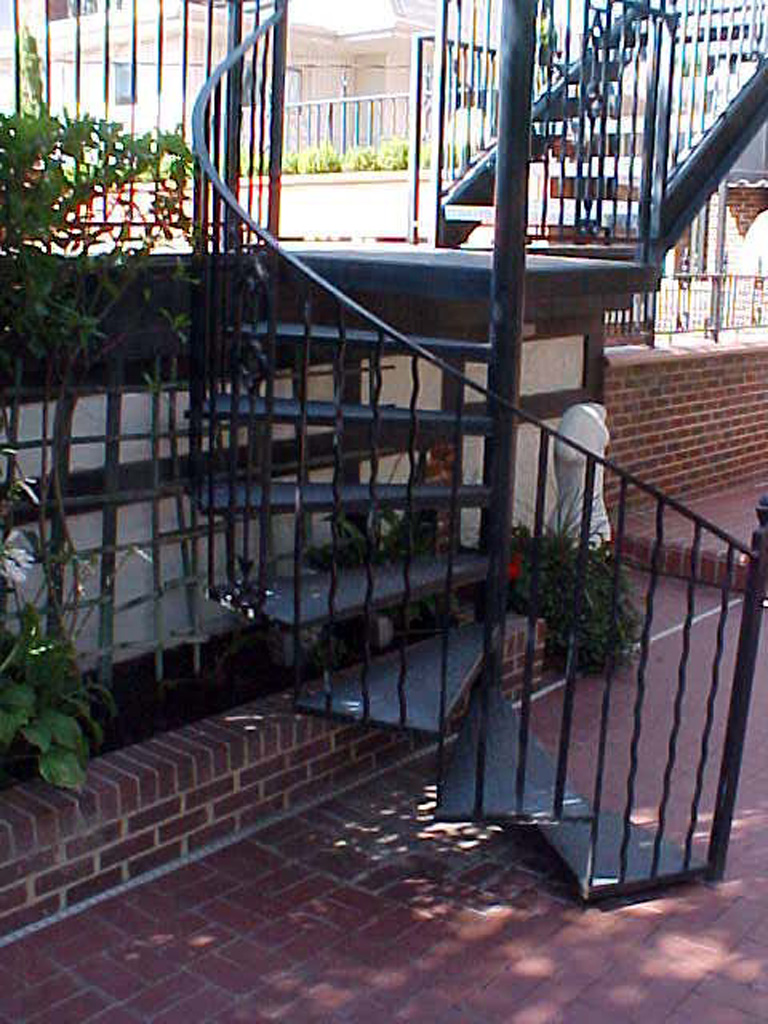 iron-anvil-railing-by-others-rail-spiral-stair-virgina-street-2-1-2