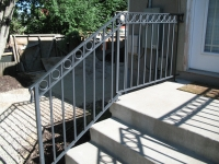 iron-anvil-railing-double-top-circles-back-deck-1