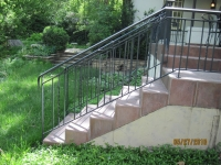 iron-anvil-railing-double-top-circles-twist-home-on-yale-anti-pattern-in-new-rail