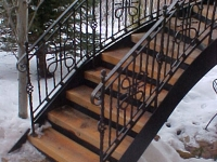 iron-anvil-railing-scrolls-and-patterns-panels-castings-circular-stair-park-city-1