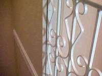 iron-anvil-railing-scrolls-and-patterns-repeating-steel-patterns-white-railing-by-others-1-2