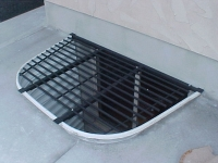 iron-anvil-security-grates-adjustable-cement-1