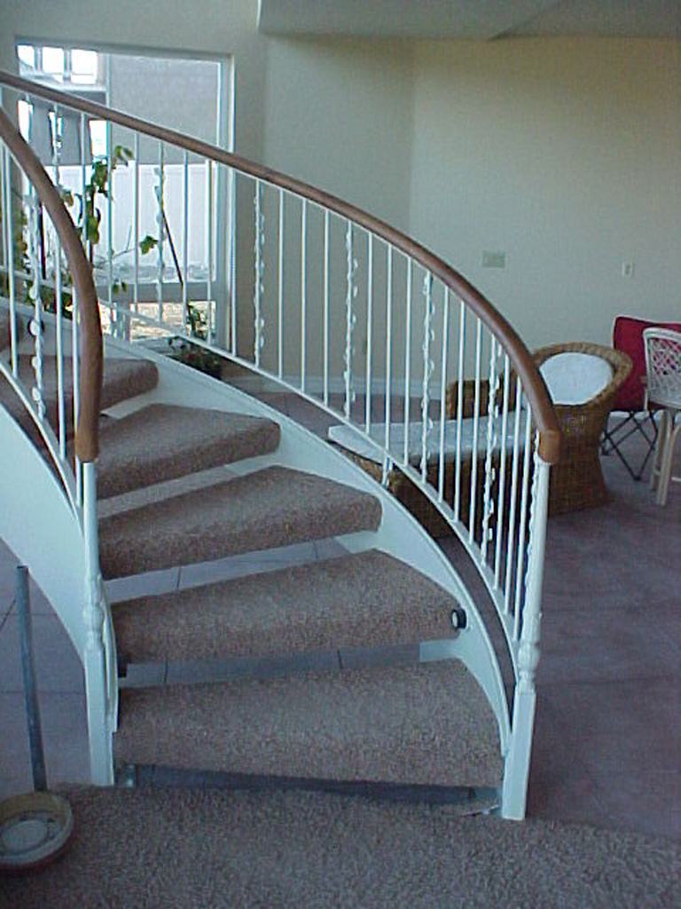 41-0050-iron-anvil-stairs-grand-circular-treads-angle-iron-wood-treads-jensen-wally-stair-saratoga-springs-2