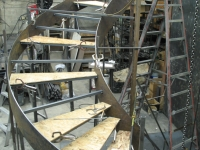 41-0060-iron-anvil-stairs-grand-circular-treads-concrete-13415-ferran-kilgore-4