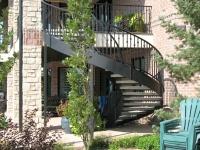 41-0060-iron-anvil-stairs-grand-circular-treads-concrete-13415-ferran-kilgore-6