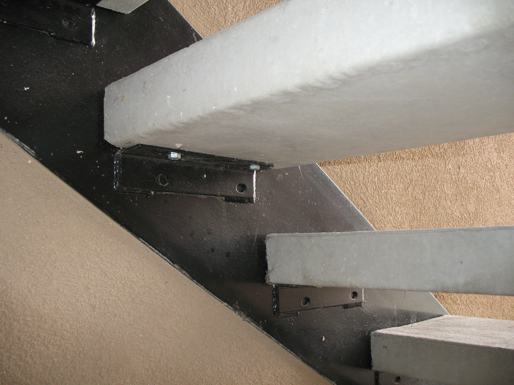 iron-anvil-stairs-double-stringer-treads-concrete-smooth-2