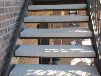 iron-anvil-stairs-double-stringer-treads-concrete-diamond-pattern-gustaferson-7