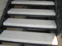 iron-anvil-stairs-double-stringer-treads-concrete-smooth-by-others2